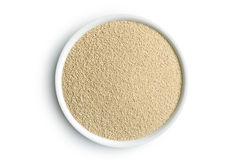 Dry yeast in bowl Royalty Free Stock Image