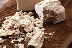 Dry yeast crumbled and yeast block for baking.  Stock Photo