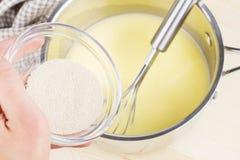 Dry yeast and warm milk Stock Photos