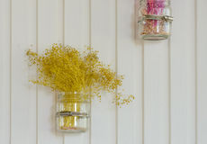 Dry yellow flower decor on wall Royalty Free Stock Images