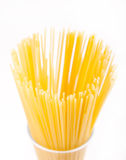 Dry yellow macaroni stand in glass Stock Photo