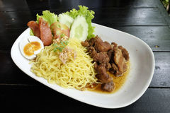 Dry Yellow Noodles with egg, salad, sausage and braised pork Royalty Free Stock Photography