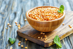 Dry yellow peas in a wooden bowl. Royalty Free Stock Photography