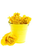 Dry yellow roses in a bucket Stock Photos