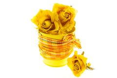 Dry yellow roses in bucket with orange ribbon Royalty Free Stock Images