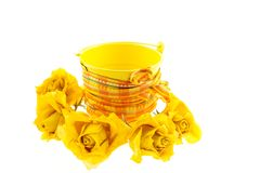 Dry yellow roses and bucket with orange ribbon Stock Images