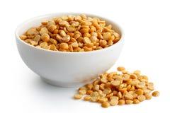 Dry yellow split peas in white ceramic bowl. Stock Image