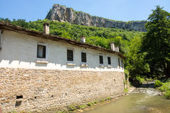 Dryanovo Monastery in Bulgaria: river, wall, mountain Stock Image
