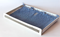 Dryer filter with lint. On a white background stock photography