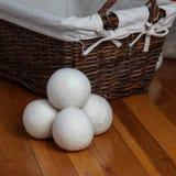 Dryer sheep ball. On floor with basket stock photo
