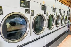 Dryers at laundromat royalty free stock photo