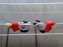 Drying baby socks Royalty Free Stock Photography