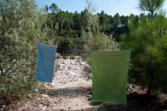 Drying bath towels in mediterranean surrounding Stock Images