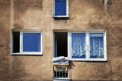 Drying bedding hang out of the window Stock Photography