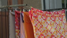 Drying bedsheets and towels outside. Laundry hanging outside to dry stock video footage