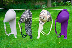 Drying bras. Colorfull and printed bras hanging on a clothesline drying Stock Images