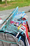 Drying cloth and hanger on cloth line Stock Photo