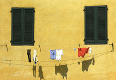 Drying clothes. In front of a house in Italy Royalty Free Stock Photos
