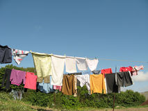 Drying clothes. Different color clothes, drying on the rope Stock Images