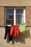 Drying clothes. Hanging from a window Royalty Free Stock Photography
