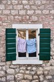 Drying clothes. Open window. The Town Of Kotor. Montenegro royalty free stock image