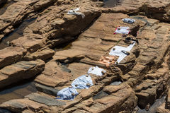 Drying clothes on the rocks in Srilankan village Stock Image