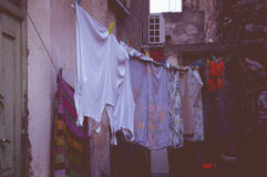 Drying clothes on a rope. In the street Greece Royalty Free Stock Image