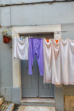 Drying clothes on the street. Stock Photos