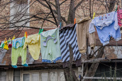 Drying clothes on a string old way Royalty Free Stock Images