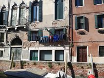 Backyards of Venice. Drying clothes under the background of old buildings. Royalty Free Stock Image