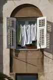 Drying jack towel on window. Drying clothes on the wall of Diocletian palace in Split town in Croatia royalty free stock images
