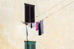 Drying clothes on the wall Royalty Free Stock Photo