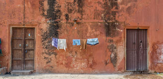 Drying cloths in India. Several cloths hanging to dry in an India ally Royalty Free Stock Photography