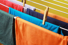 Drying colorful clothes hanged on the clothes horse Royalty Free Stock Photo