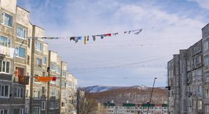 Drying colourful clothes on lines between the neighbour buildings in winter time royalty free stock photo