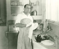 Drying the dishes Stock Images