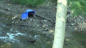 A drying and drought river near Olomouc with rubbish and plastic container, civilization problem Czech Republic, Europe. European Union stock footage