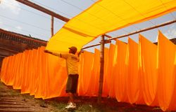 Drying fabric. Worker drying the fabric after the coloring process in solo, central java, indonesia royalty free stock photos