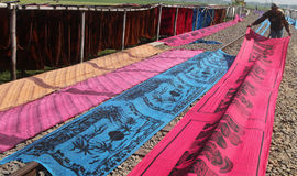 Drying fabric. Workers were drying fabric that will be used as a fabric beach in the village of Sukoharjo district Mojolaban Bekonang Thursday ( 25/6 ) . These royalty free stock photo