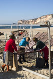 Drying fish on the beach in Nazare, Portugal Stock Images