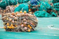 Drying fishing nets with orange floats Stock Image