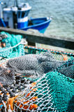 Drying fishing nets in port. At sunny day Stock Image