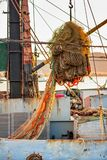 Drying fishing nets on the trawler in city harbor. At sunset of the day Royalty Free Stock Photos