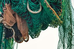 Drying fishing nets on the trawler. In city harbor at sunset of the day Stock Photography