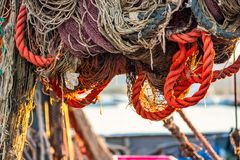 Drying fishing nets on the trawler. In city harbor at sunset of the day royalty free stock photos