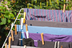 Drying frame with clothes in the garden Royalty Free Stock Images