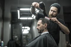 Drying hair in barbershop Stock Photos