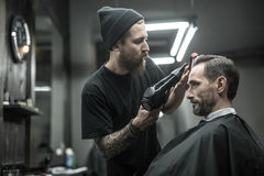Drying hair in barbershop Stock Images