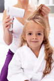 Drying hair - personal hygiene Royalty Free Stock Photography