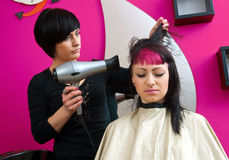 Drying hair in salon Royalty Free Stock Photos